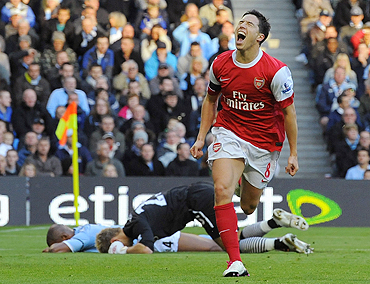 Arsenal's Samir Nasri (right) celebrates after scoring against Manchester City on Sunday
