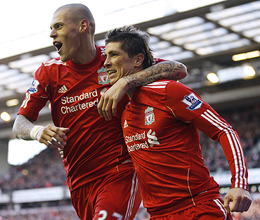 Liverpool's Fernando Torres (right) celebrates with Martin Skrtel (left) after scoring against Blackburn Rovers on Sunday