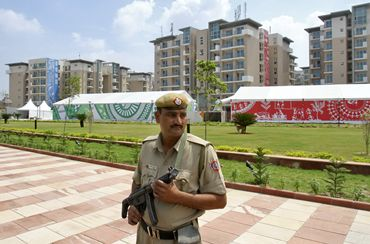 A policeman stands guard at the 2010 Commonwealth Games village