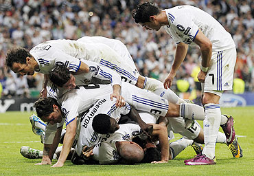 Real Madrid's players celebrate after Angel Di Maria's goal against Tottenham Hotspur