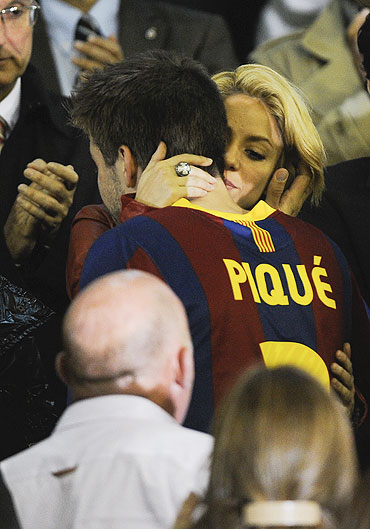 Shakira comforts Barcelona's Gerard Pique after the Copa del Rey final on Wednesday