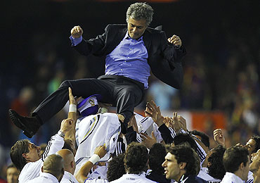 Real Madrid players celebrate with coach Jose Mourinho after winning the Copa del Rey final against Barcelona