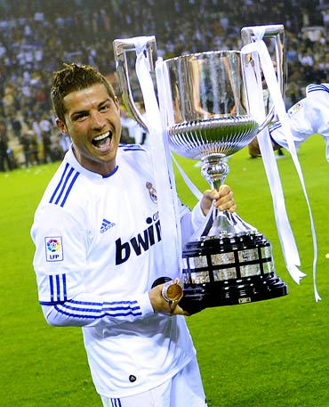 Cristiano Ronaldo celebrates with the trophy after winning the King's Cup final against Barcelona