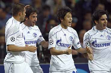 Schalke players celebrate after scoring a goal