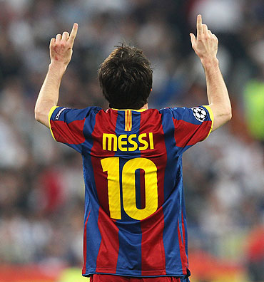Lionel Messi celebrates after scoring his second goal