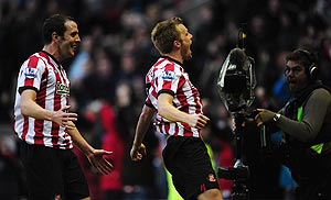 Sunderland's Sebastian Larsson (right) and John O' Shea celebrate the winning goal