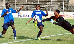 Dempo players in action with Sporting players
