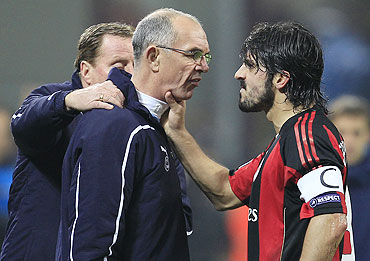 AC Milan's Gennaro Gattuso (right) argues with Tottenham Hotspur's assistant coach Joe Jordan (centre) as manager Harry Redknapp tries to seprerate them on Tuesday
