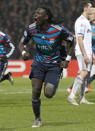 Olympique Lyon's Bafetimbi Gomis celebrates his goal against Real Madrid during their Champions League match at the Gerland stadium