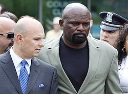 lawrence taylor outside the court