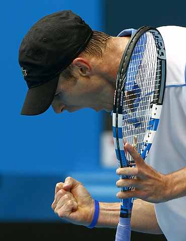 Andy Roddick reacts after winning his match at the Australian Open