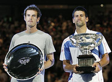 Novak Djokovic and Andy Murray (left) with their trophies after their men's singles final on Sunday