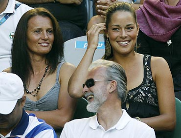 Serbian tennis star Ana Ivanovic (top right) watches the men's singles final on Sunday
