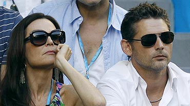 Australian actor Eric Bana and his wife Rebecca Gleeson watch the men's singles final on Sunday