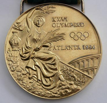 Olympians, THE OLYMPIC CHAMPIONS BITE THEIR MEDALS