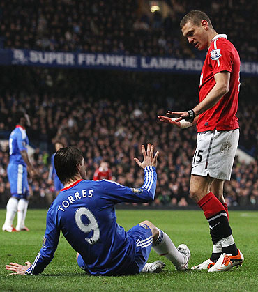 Manchester United's Nemanja Vidic (right) exchanges words with Chelsea's Fernando Torres