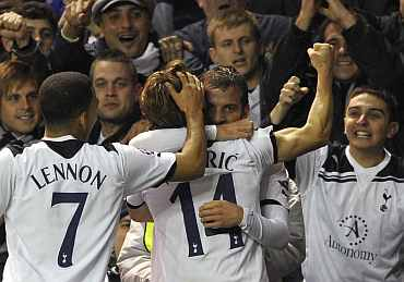 Tottenham players celebrate after scoring a goal