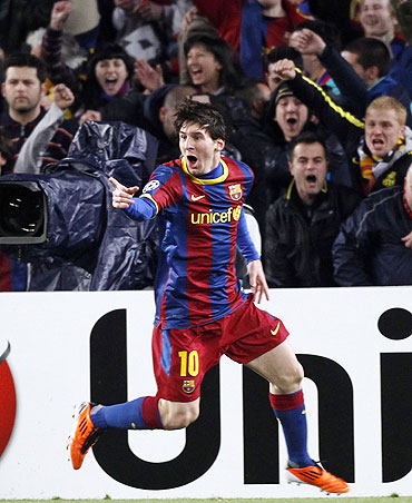 Barcelona's Lionel Messi celebrates after scoring the first goal against Arsenal on Wednesday