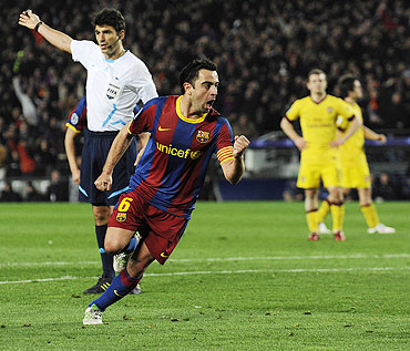 Barcelona's Xavi Hernandez (centre) celebrates after scoring against Arsenal