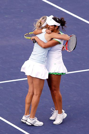 Sania and Elena hug each other after clinching victory