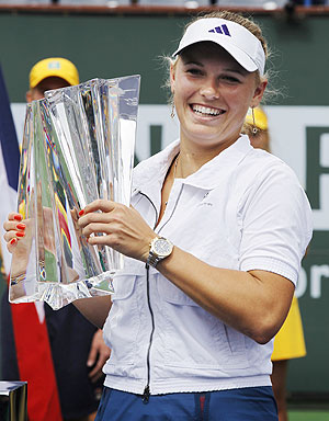Caroline Wozniacki holds the winners trophy at Indian Wells