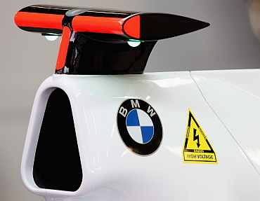 Team BMW Sauber car displays a warning sign for high voltage due to the new KERS energy system