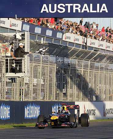Red Bull's Sebastian Vettel crosses the line winning the Australian Grand Prix