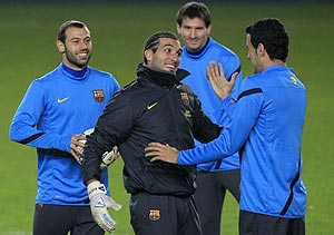 Barcelona's players (left to right) Sergio Busquets, Jose Pinto, Lionel Messi and Javier Mascherano share a laugh during a practice session in Prague
