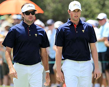 Watson of the US Team with team-mate Webb Simpson