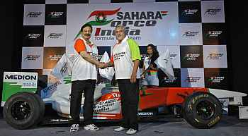 Vijay Mallya, co-owner of the Force India Formula One team and Sahara Group Chairman SubrataRoy attend a news conference in New Delhi
