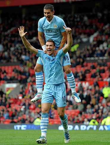 Manchester City's Edin Dzeko celebrates after scoring against Manchester United