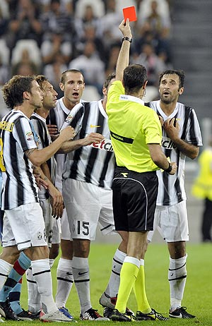 Juventus's Mirko Vucinic (right) is shown the red card during their Serie A soccer match against Bologna