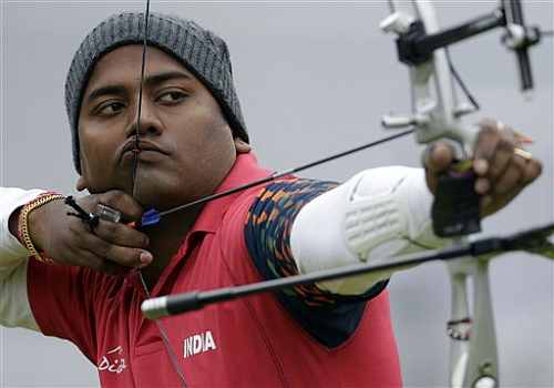 India's Jayanta Talukdar shoots during an elimination round of the individual archery competition