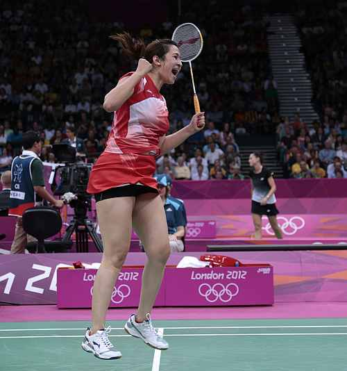 ndia's Jwala Gutta jumps up after winning their match