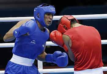 Boxer Manoj Kumar storms into last 16