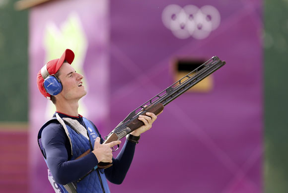Britain's Peter Robert Russell Wilson celebrates after winning in the men's double trap shooting event