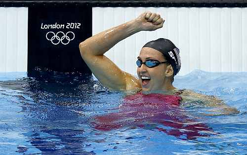 United States' Rebecca Soni reacts to her record-setting finish in the women's 200-meter breaststroke swimming semifinal