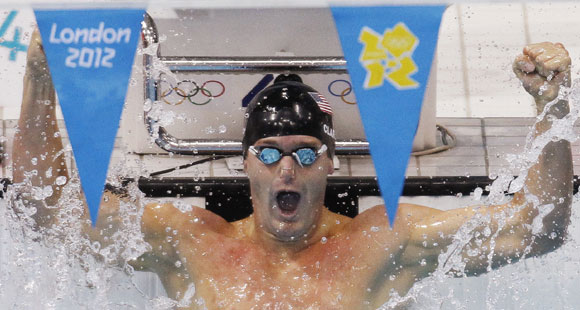 Tyler Clary of the U.S. celebrates winning the men's 200m backstroke final with an Olympic record