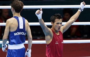 Devendro beats Beijing Games silver medalist to enter QF