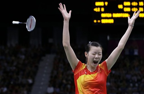 China's Li Xuerui celebrates after beating Wang Yihan