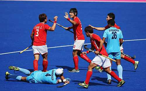 Nam Hyun Woo of South Korea celebrates with team mates after his goal during the Men's Hockey match between India and South Korea