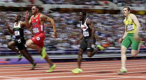rom left, Ivory Coast's Ben Youssef Meite, United States' Ryan Bailey, Canada's Justyn Warner and Lithuania's Rytis Sakalauskas compete in a men's 100-meter heat