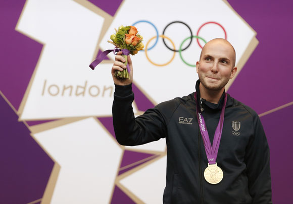 Gold medallist Italy's Niccolo Campriani poses at the men's 50m rifle shooting from 3 positions victory ceremony