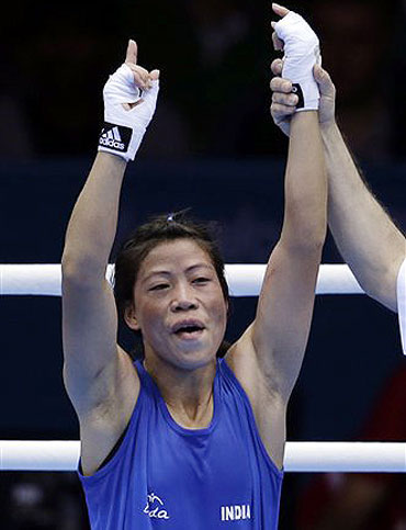 India's Chungneijang Mery Kom Hmangte celebrates after defeating Tunisia's Maroua Rahali in a women's flyweight 51-kg quarterfinal boxing match at the 2012 Summer Olympics