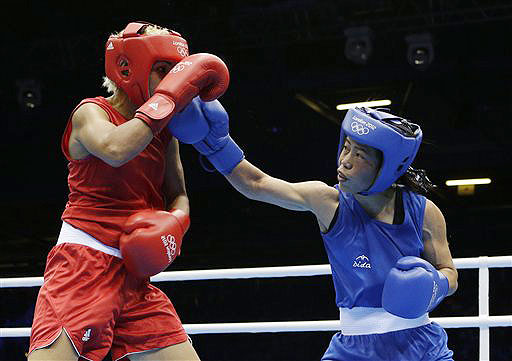 India's Chungneijang Mery Kom Hmangte, right, fights Tunisia's Maroua Rahali during a women's flyweight 51-kg quarterfinal boxing match