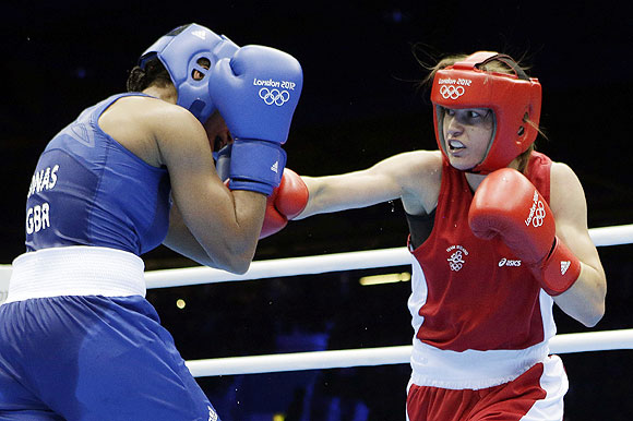 Ireland's Katie Taylor (right) throws a punch at Britain's Natasha Jonas in a women's lightweight 60-kg quarter-final boxing match on Monday