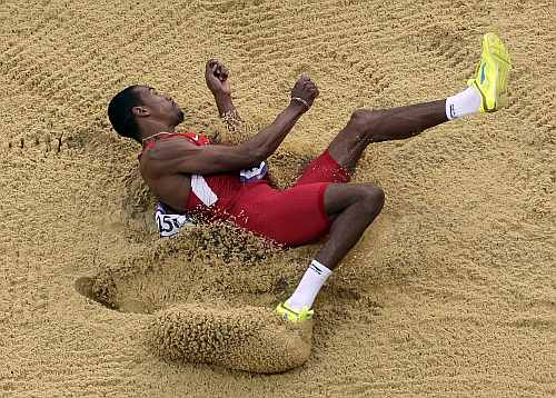 United States' Christian Taylor takes a jump during the men's triple jump final in the Olympic Stadium