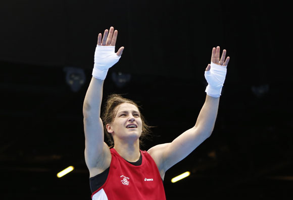 Ireland's Katie Taylor reacts as she is declared the winner over Russia's Sofya Ochigava after their Women's Light (60kg) gold medal