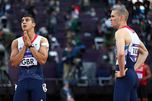 Adam Gemili of Great Britain reacts next to Daniel Talbot of Great Britain after the Great Britain team was disqualified during the Men's 4 x 100m Relay Round 1 heats