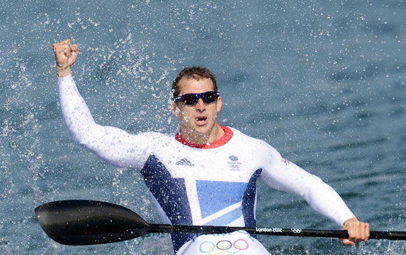 Ed Mckeever of Great Britain celebrates winning gold in the Men's Kayak Single (K1) 200m Canoe Sprint